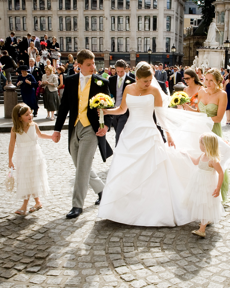 Bride & Groom in Paternoster Square. St Paul's Cathedral wedding photographer Wild Weddings