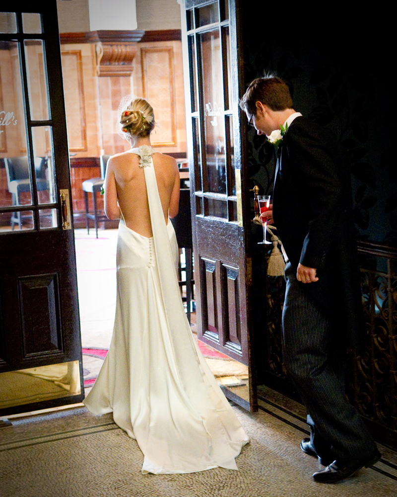Bride in gown. One Whitehall Place. wedding photographer Wild Weddings