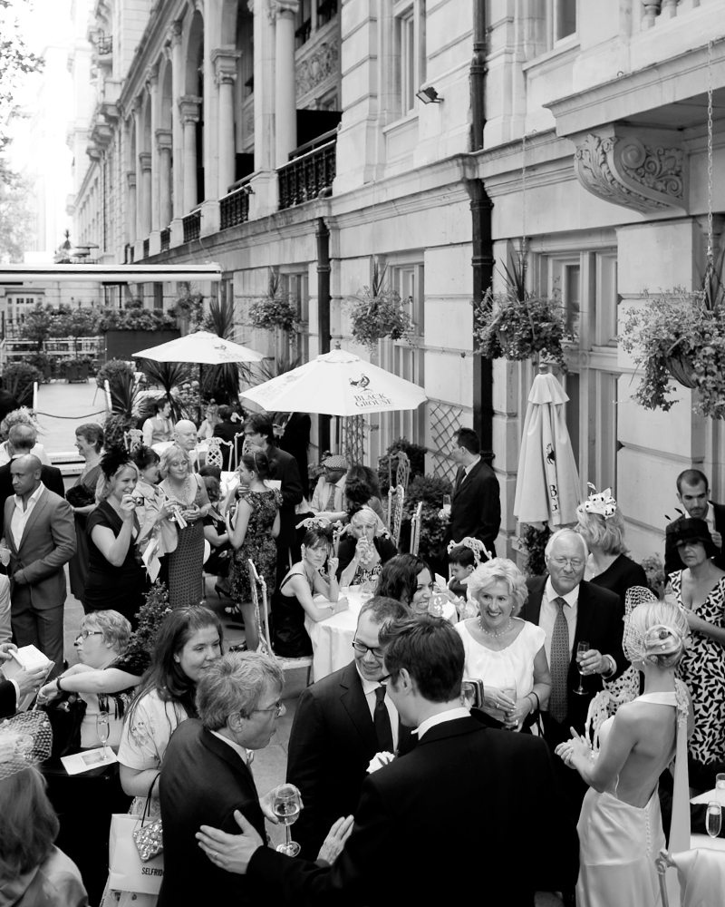 Drinks reception on terrace. One Whitehall Place. wedding photographer Wild Weddings