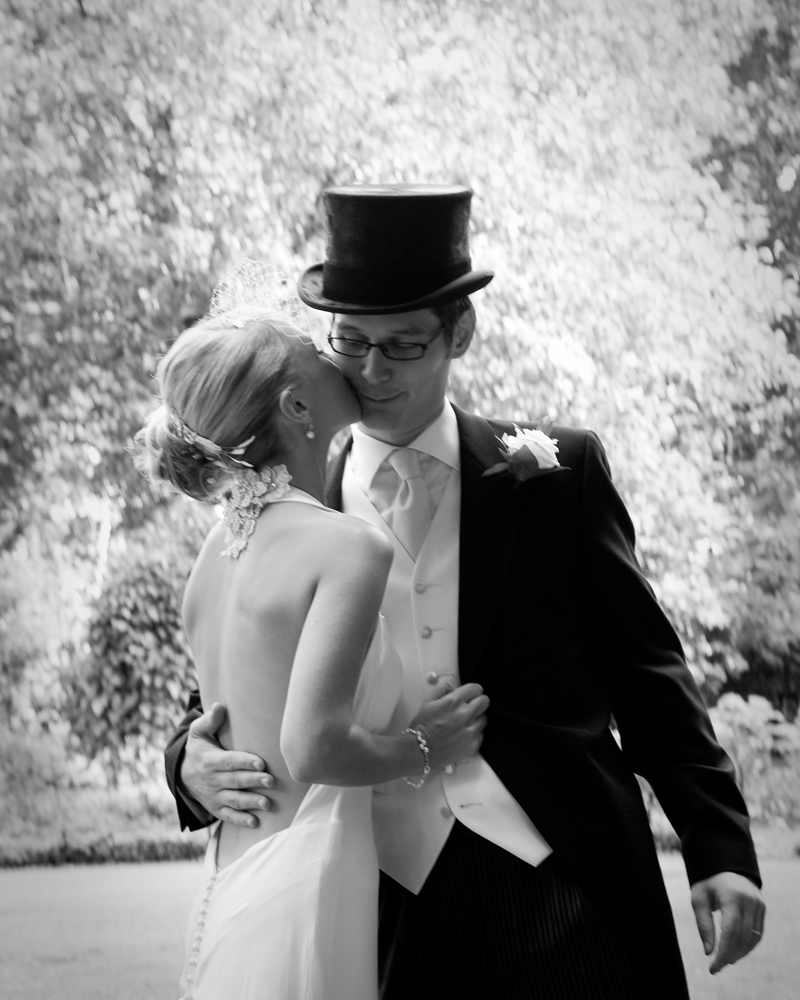Bride and groom. Top hat. One Whitehall Place. wedding photographer Wild Weddings