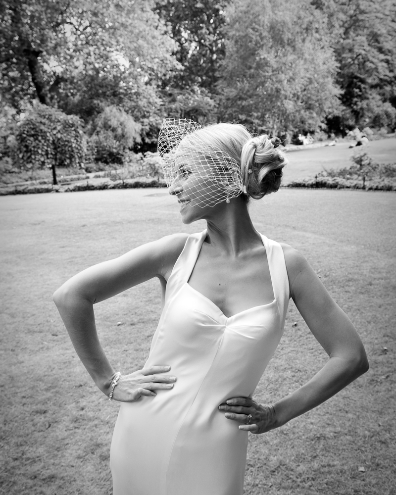 Bride in garden. One Whitehall Place. wedding photographer Wild Weddings