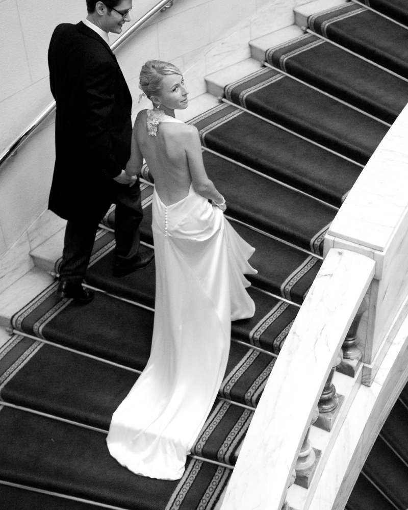 Staircase with bride and groom. One Whitehall Place. wedding photographer Wild Weddings