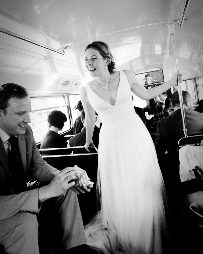 Bride on London bus. Knightsbridge wedding photographer Wild Weddings