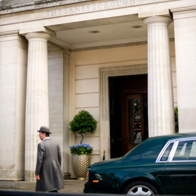 Doorman and car. The Lanesborough wedding photographer - Wild Weddings