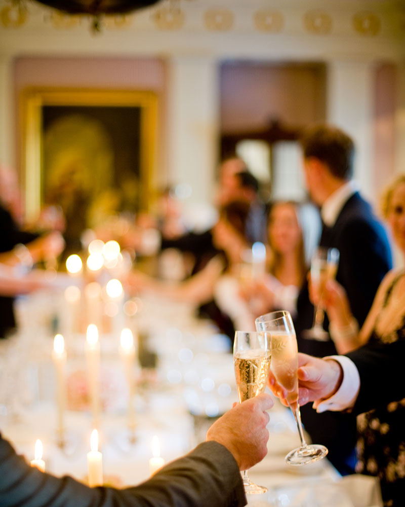 Toasting at dinner. The Lanesborough wedding photographer - Wild Weddings