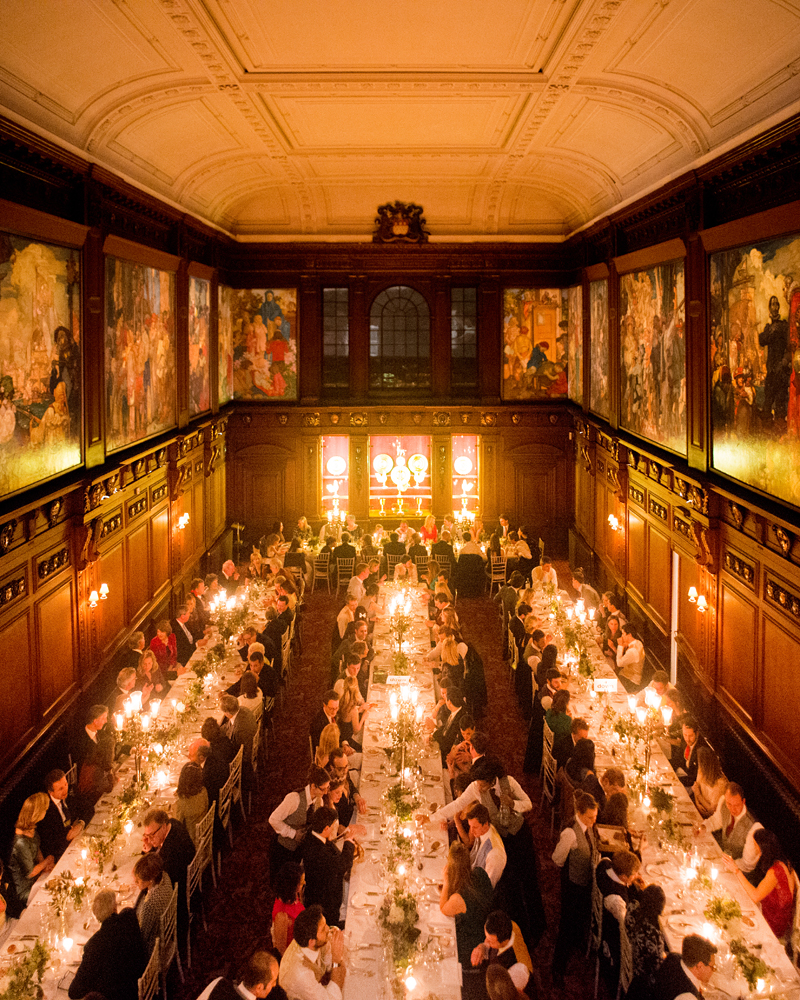 The Great Hall dressed for a candlelit dinner. Skinners' Hall wedding photographer Wild Weddings