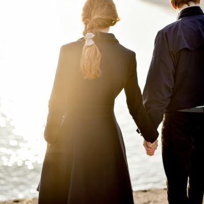 Engagement portrait photography by Wild Weddings on the Cobb Lyme Regis Dorset