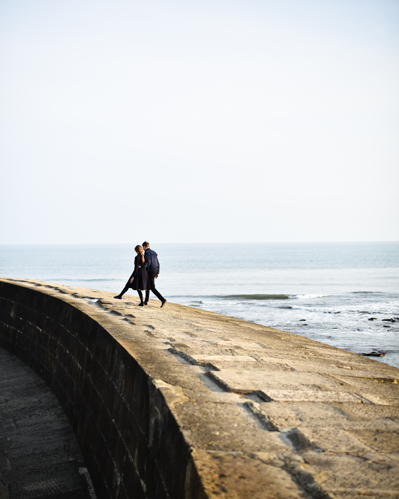 Engagement portrait photography by Wild Weddings on the Cobb Lyme Regis Dorset